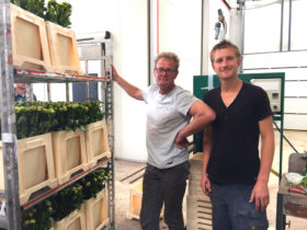 Wim and Joost Borst with a trolley peonies